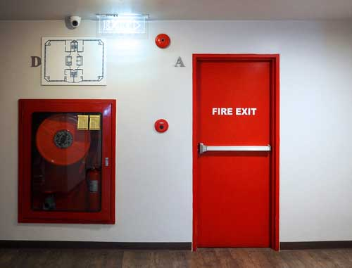 red fire exit door with exit handle